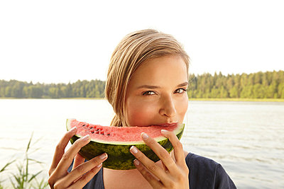 Young woman with water melon - p7880019 by Lisa Krechting