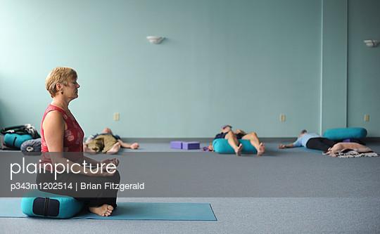 Senior adults participate in a yoga class.