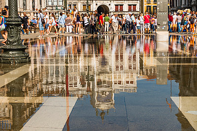 Italy, Veneto, Venice, Piazza San Marco, Torre dell'Orologio and tourists, water reflection - p300m975454f by Karl Thomas
