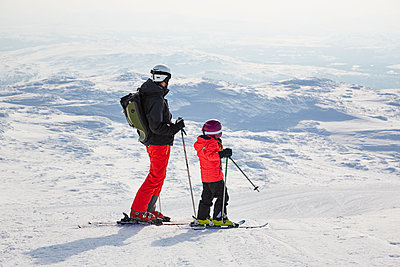 Father and son skiing - p312m2052512 by Lina Arvidsson