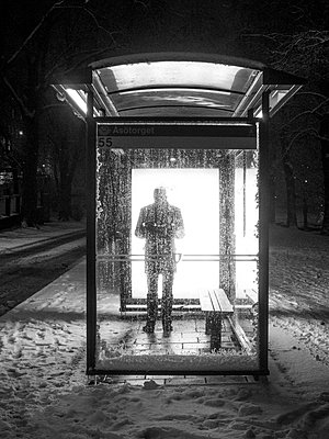 Silhouette Of A Person Waiting In The Bus Shelter At Night  - p847m1443801 by Johan Strindberg
