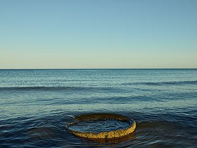 Scrap metal floating in Baltic Sea - p1200m1131681 by Carsten Görling