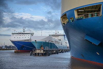 Ships docked in harbor - p429m747085f by Monty Rakusen