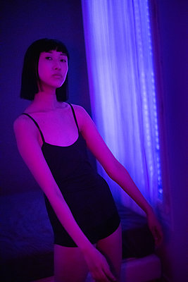Asian woman in black mini dress - p1321m2211717 by Gordon Spooner