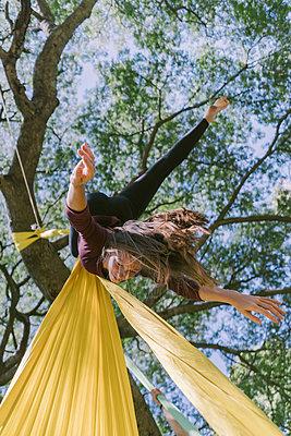 Aerial Silks Performer Hanging On A Tree - p1166m2106797 by Cavan Images