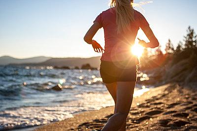 Runner on Hidden Beach, Tahoe, CA - p343m1112084f by Gabe Rogel