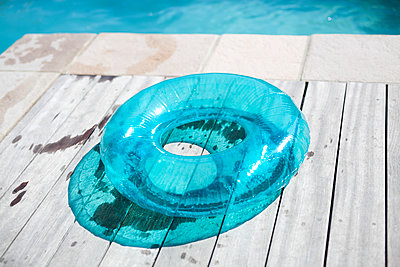 Swimming ring on wooden pier - p699m2043671 by Sonja Speck