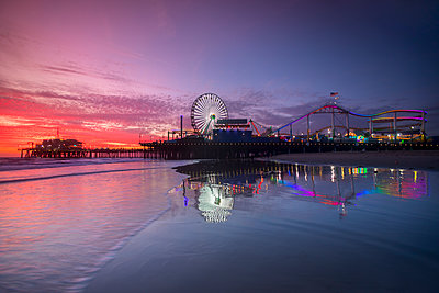 Amusement park and Santa Monica Pier at sunset, Los Angeles, California, USA - p343m1569089 by Sean Davey