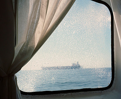 View through a ship window - p4902800 by Jan Mammey