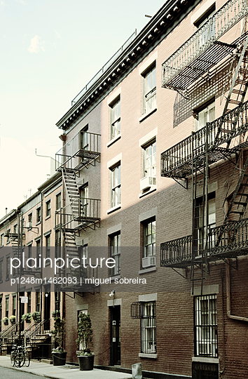 Buildings with fire escape in Greenwich Village  - p1248m1462093 by miguel sobreira