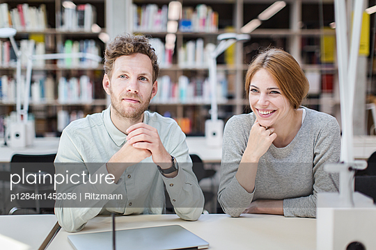 Students learning together in library - p1284m1452056 by Ritzmann