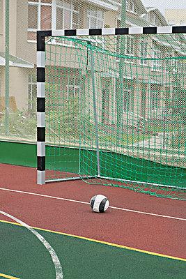A soccer ball near a soccer goal - p30120068f by Vladimir Godnik