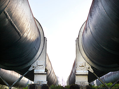 Low angle view between two hydroelectric industrial pipes, Tasmania - p429m1181345 by Elke Meitzel