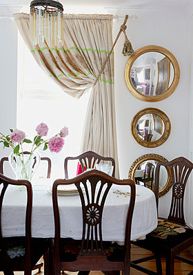 Convex mirrors in dining room of 18th Century Georgian terrace - p349m789949 by Brent Darby