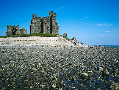 Piel Castle. the castle with pebble beach and sea in foreground. - p8551777 by Jonathan Bailey