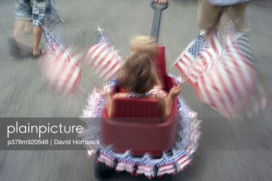 Children waving American flags - p378m920548 by David Hornback