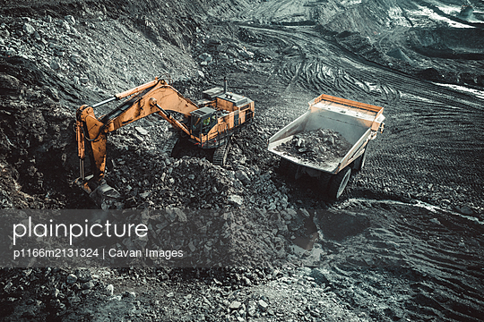 Excavator Loading Coal Truck from Aerial View - p1166m2131324 by Cavan Images