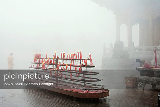 Buddhist temple in mist - p37816520 by James Sebright