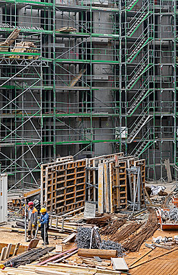 Construction workers on large construction site - p1292m2182586 by Niels Schubert
