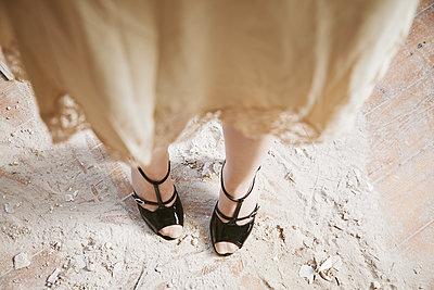 Woman's legs in an abandoned house - p1540m2141282 by Marie Tercafs