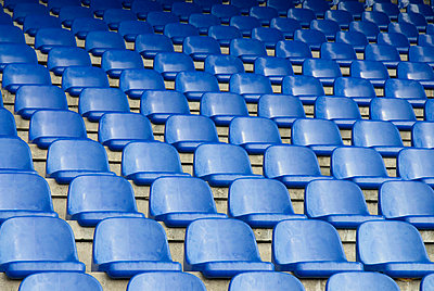 Empty seats in a sports stadium - p30112058f by Martin Holtkamp