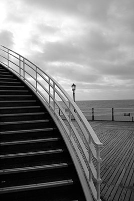 Steps in the foreground on Worthing Pier with the sea in the background - p3313109 by Gail Symes