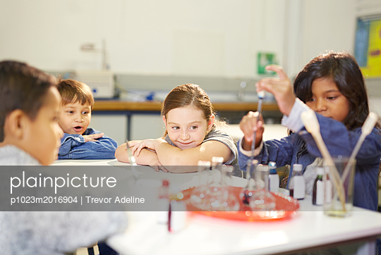 Curious kids conducting science experiment - p1023m2016904 by Trevor Adeline