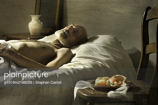 Old man in bed - p1019m2148259 by Stephen Carroll