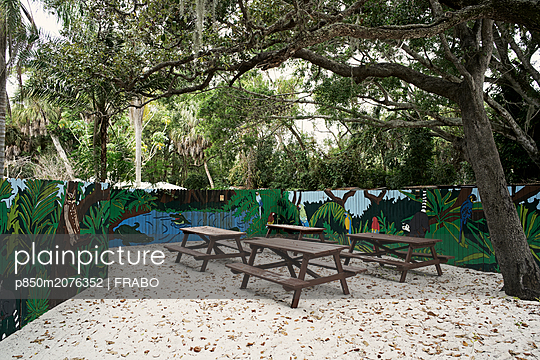 Picnic tables and graffiti fence - p850m2076352 by FRABO