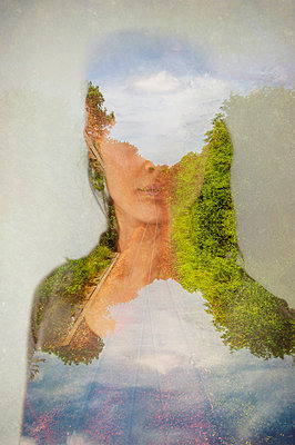 Collaged abstract portrait of woman overlaid with rural train tracks - p1047m2039092 by Sally Mundy