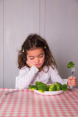 Girl dislikes vegetables - p1231m1209057 by Iris Loonen