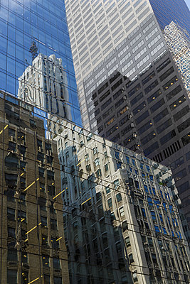 Reflections in glass facades of skyscrapers - p1280m2182464 by Dave Wall