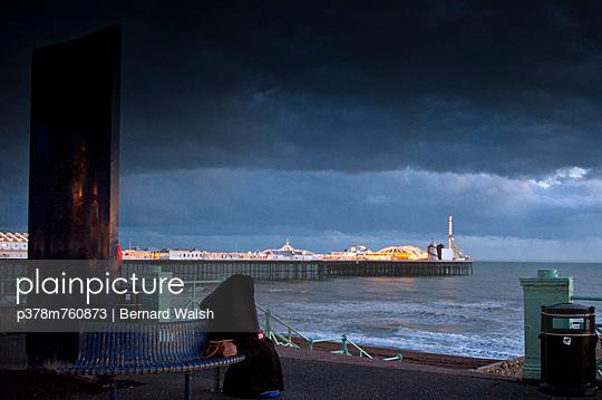 Lone woman by pier - p378m760873 by Bernard Walsh