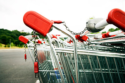 Shopping carts in a parking lot - p1084m1036785 by GUSK