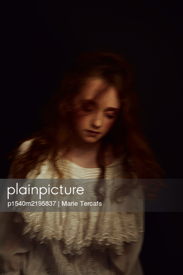 blurred portrait of a romantic little girl wearing a white dress - p1540m2195837 by Marie Tercafs
