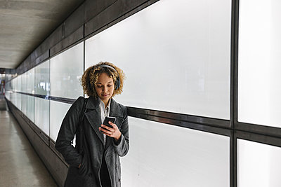 Woman with headphones and smartphone - p300m2143439 by Hernandez and Sorokina