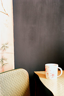 Tabletop and chair with mug - p349m695137 by Emma Lee