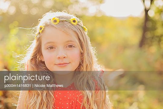 Portrait of relaxed little girl wearing flower wreath