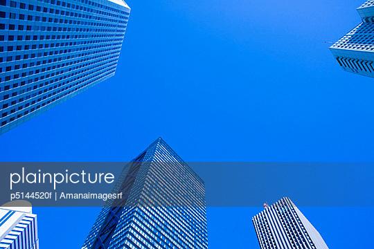 High rise complex against blue sky. Shinjuku-ku, Tokyo Prefecture, Japan