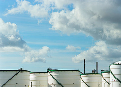 Grain silos under blue sky - p42919038f by Mischa Keijser