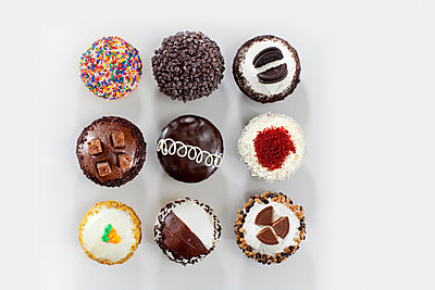 Chocolate cupcakes arranged in grid - p924m807341f by Chad Springer