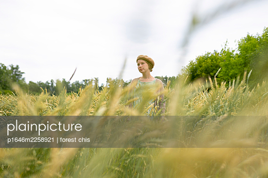 Woman in cornfield - p1646m2258921 by Slava Chistyakov