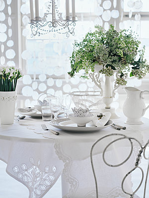 A set table in a garden pavilion Sweden. - p312m1077346f by Mikael Dubois