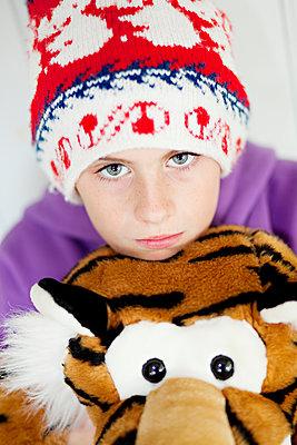 Portrait of boy hugging teddy bear - p312m1551944 by Johner Images