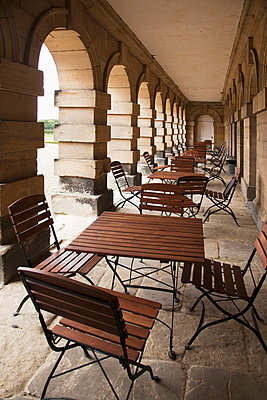 Chairs And Tables In An Outdoor Corridor; Northumberland England - p442m700407 by John Short