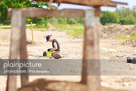 Archaeologist at work - p312m2208245 by Phia Bergdahl