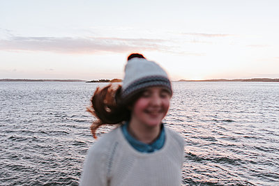 Girl by the ocean - p1507m2165754 by Emma Grann