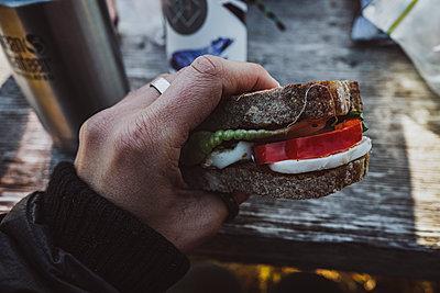 Hand holding sandwich - p312m2208100 by Rania Rönntoft