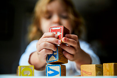 Young Girl Holding Alphabet Blocks - p669m1443137 by Kelly Davidson