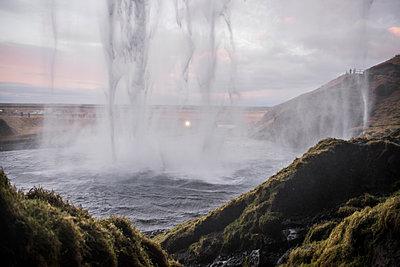 View from behind waterfall, Seljalandsfoss, Iceland - p924m1139389 by Rosanna U